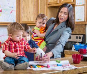 busy mother gathering children in kitchen