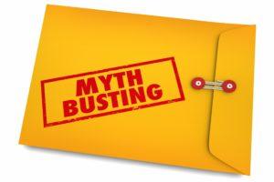 Yellow envelop busting dental implant myths.